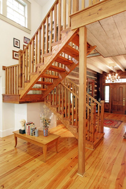Log cabin open staircase reclaimed wood