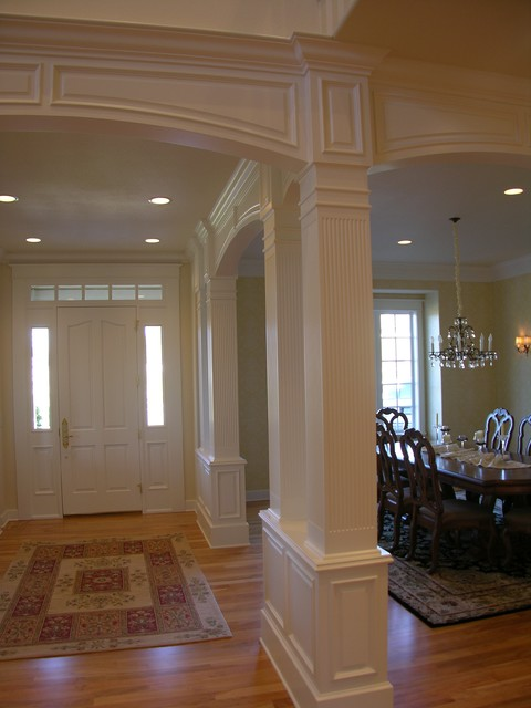 Traditional stair with painted wainscoting  Traditional