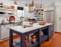 White kitchen with copper and navy blue accents ...