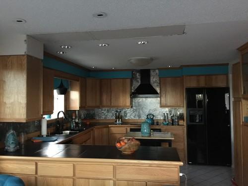 Recessed lighting over kitchen peninsula