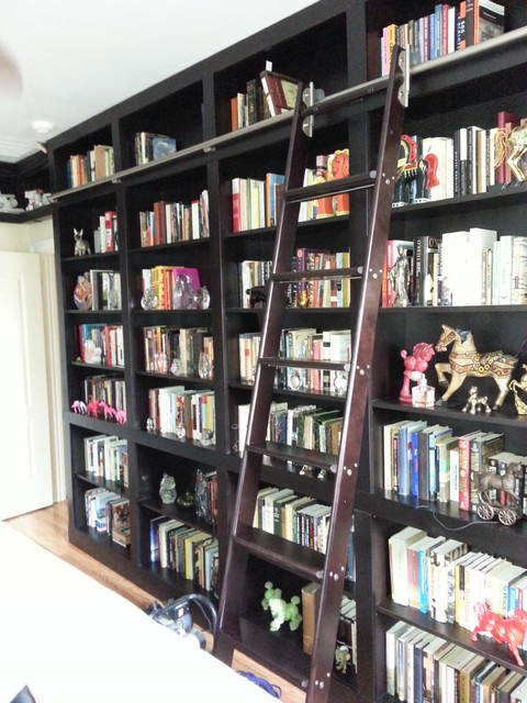 Builtin Bookcases with Rolling Ladder and Hidden Vault