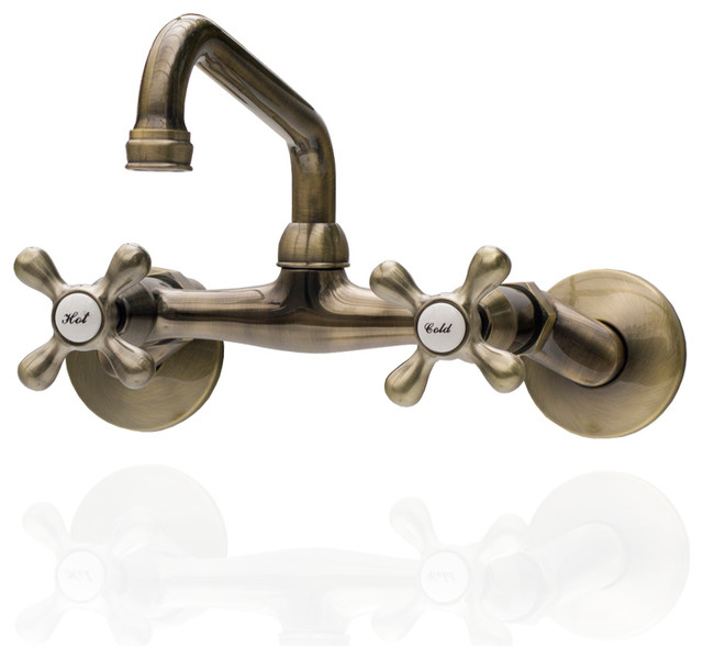 antique style brass wall mount farm faucet adjustable centers cross handles