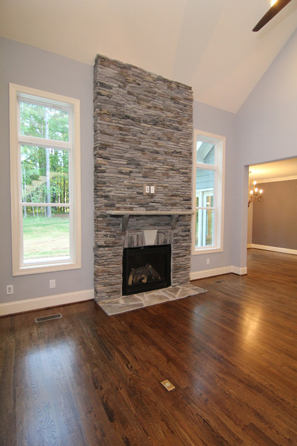 Two story fireplace surround  Transitional  Living Room  Raleigh  by Stanton Homes