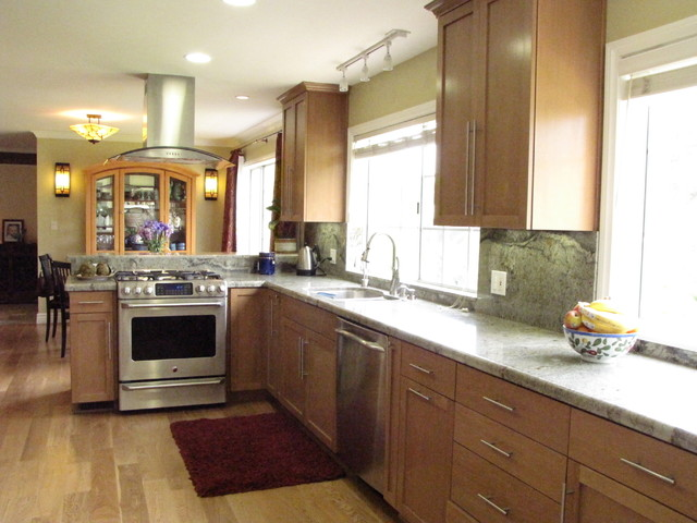 Transitional Kitchen with wood floors and birch cabinets