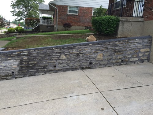 Paint over stone retaining wall in driveway.
