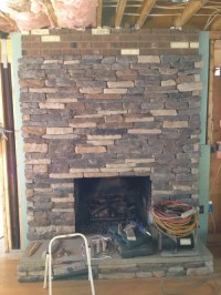Adjacent wallpaper to stone fireplace?