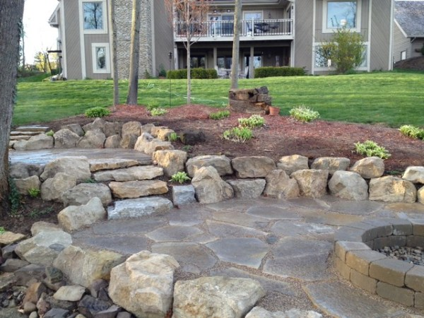 tiered flagstone patio boulders firepit