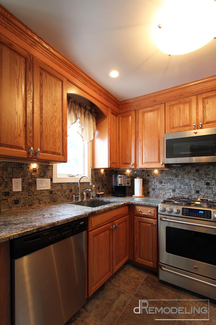 Slate Laminate Countertop Stainless Appliances And Hardware With Oak Cabinets