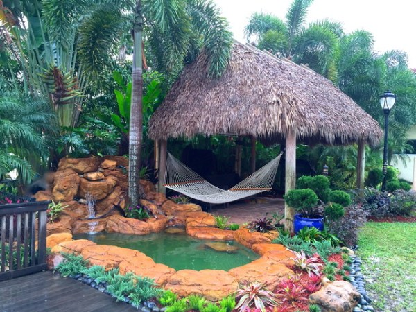 tiki hut and waterfall - tropical
