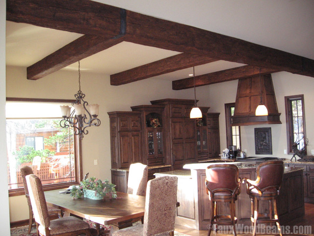 kitchen area rugs for hardwood floors automatic soap dispenser dining room with faux wood beams - traditional ...