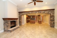 Great Room with Stone Fireplace and Archway - Transitional ...