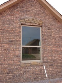 How to fix this stone over window