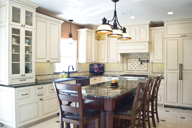 Traditional Kitchen With White Painted Cabinets With