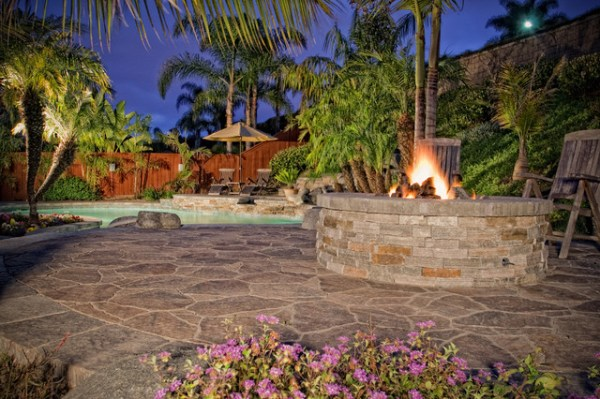 tropical pool with firepit