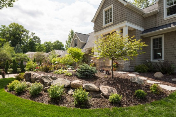 front yard with boulder wall