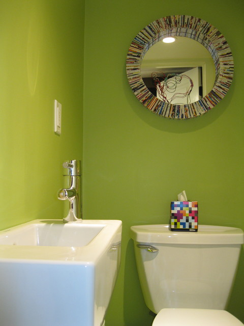 Tiny bright green powder room with Duravit wall mount