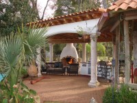 Houston Spanish style patio with fireplace and ...