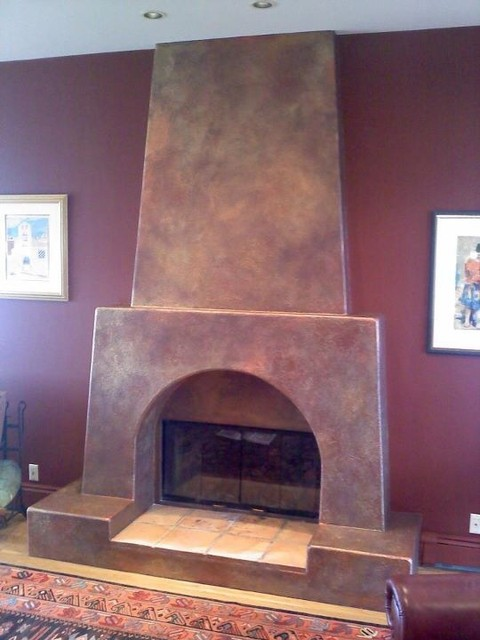 Adobe Fireplace Rustic Living Room New York By