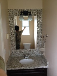 Build a mosaic tile mirror in the small bathroom. Good