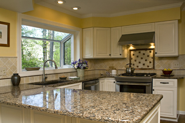 Sunny Tuscan Inspired Kitchen with Beautiful Bronze