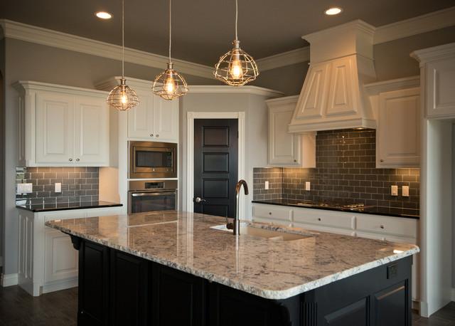 Kitchen With White Cabinets And Dark Island Transitional Kitchen