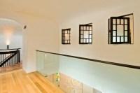 Glass interior wall and pivoting interior windows ...