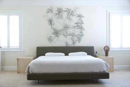 Metal Sculpture Pieces Above The Bed