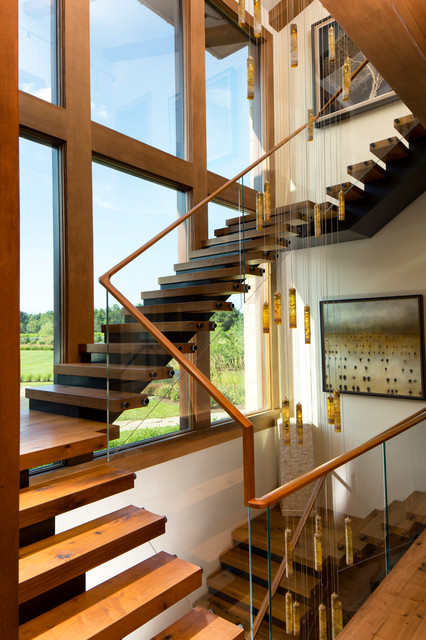 Threestory floating wood and steel entry staircase