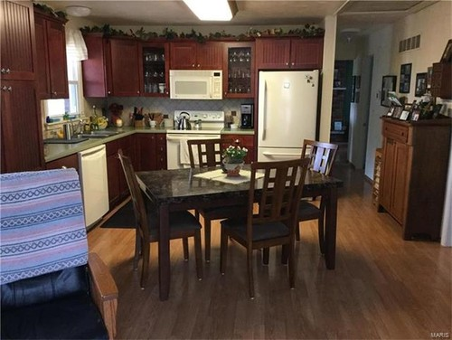 Kitchen And Dining Room With Connected Entryway