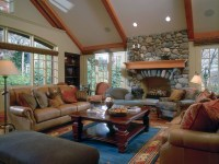 Living Room with full stone fireplace and vaulted ceiling ...