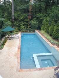 Lap pool fits on long skinny lot. Walls above and below ...