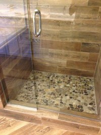 Shower remodel: Natural look with mosaic flat rock pebbles ...