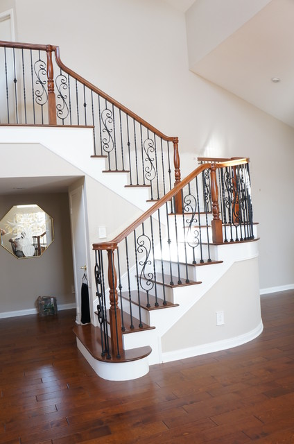 Wood and Iron railings  Traditional  Staircase  Orange