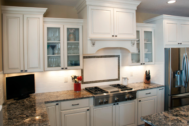 Elegant L Shaped Kitchen Photo In New York With Raised Panel Cabinets White