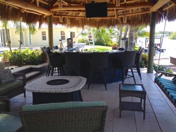 tiki hut outdoor kitchen and landscaping