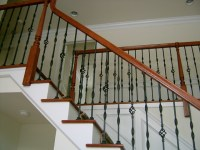 Steel ornamental balusters with wood handrail ...