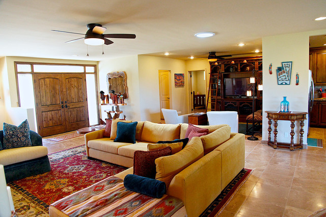 Like An Oasis In The Desert Warm Sandy Hues Are Center Of This Southwestern Living Room Decorating Style A Leather Sofa Is Matched With Soft Hued