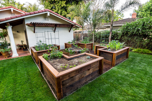 this yard has some interesting and well designed raised garden beds these beds are so