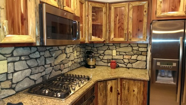 rustic kitchen with stone backsplash Rustic Red Cedar Kitchen with cultured Stone Backsplash