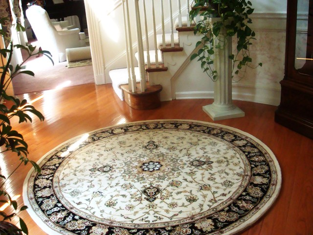 Round Rug with Curved Staircase  Traditional  Entry