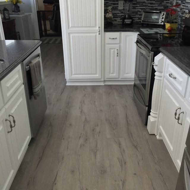 Beautiful Tile Backsplash  LVP Flooring  Modern  Kitchen  Raleigh  by Adams Carpet One