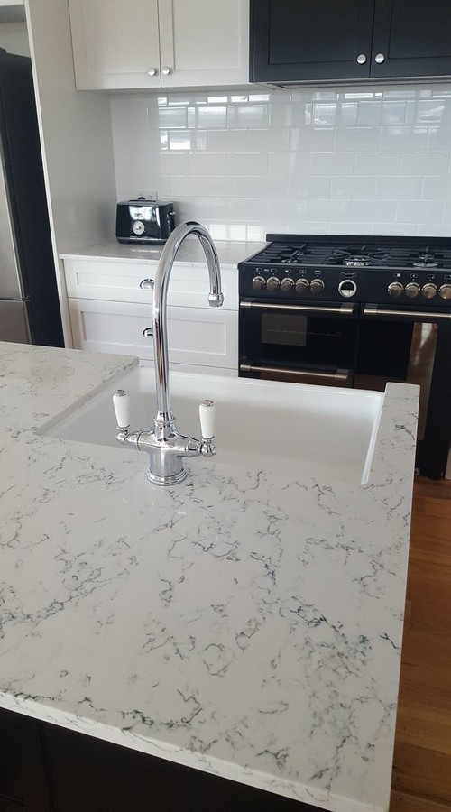 installing kitchen countertop kohler faucets parts caesarstone white attica quartz countertops