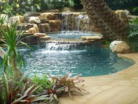 Tropical backyard pool waterfall into jacuzzi - Tropical ...
