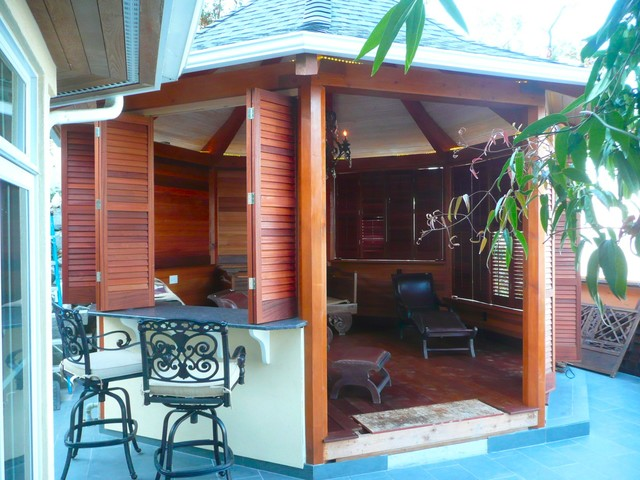 mahogany side tables living room fireplace wall gazebo with plantation shutters - tropical porch ...