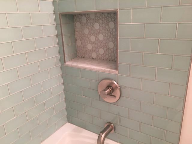bath with seafoam glass subway tiles