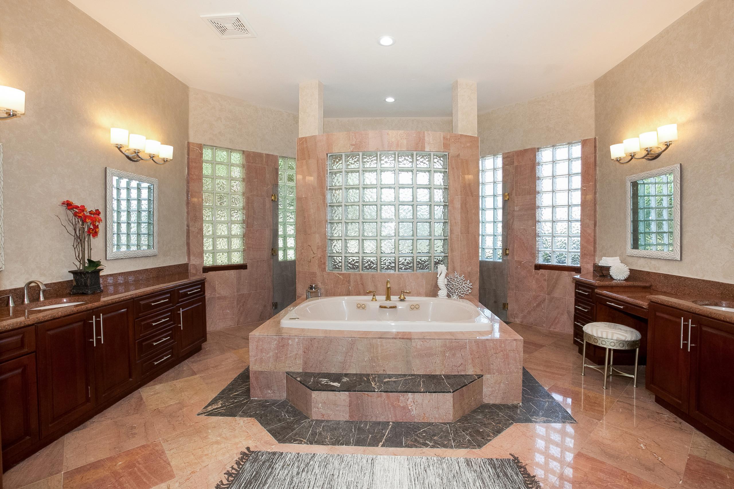 pink tile travertine floor bathroom