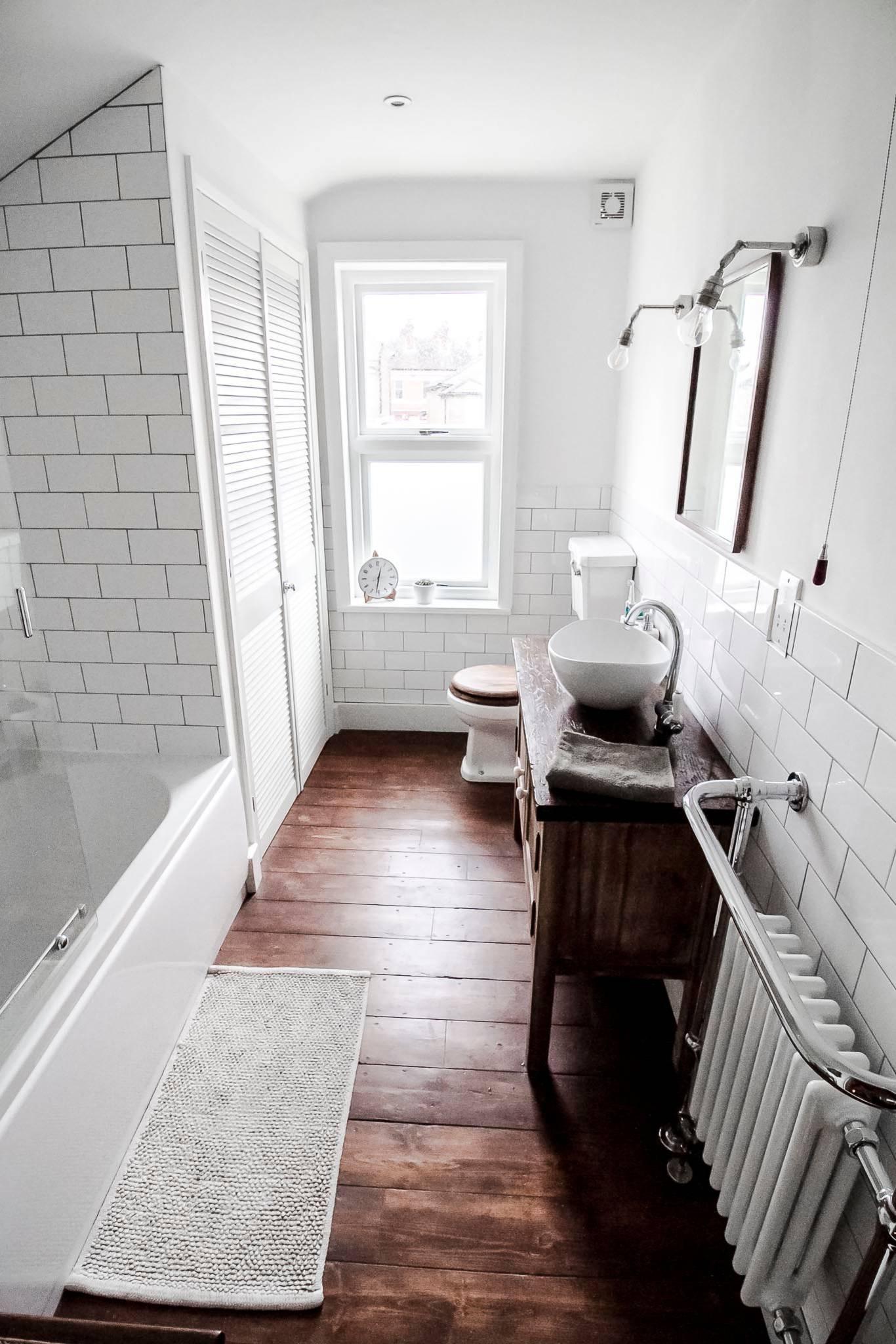 subway tile dark wood floor bathroom