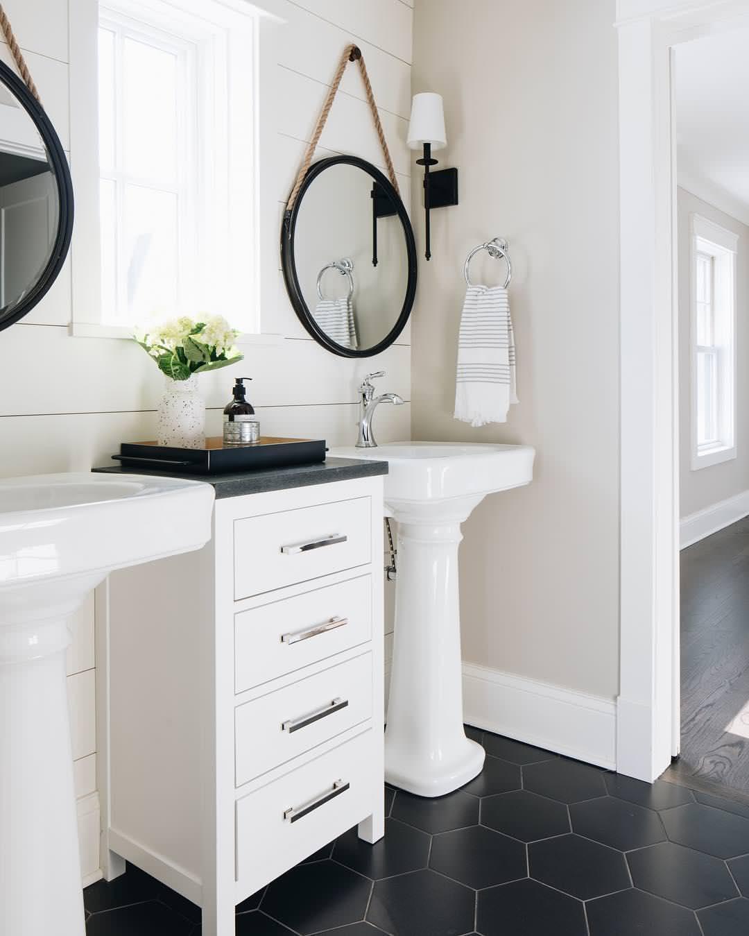 farmhouse bathroom with a pedestal sink