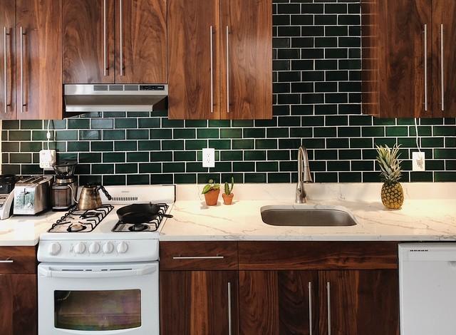 dark green tile backsplash eclectic