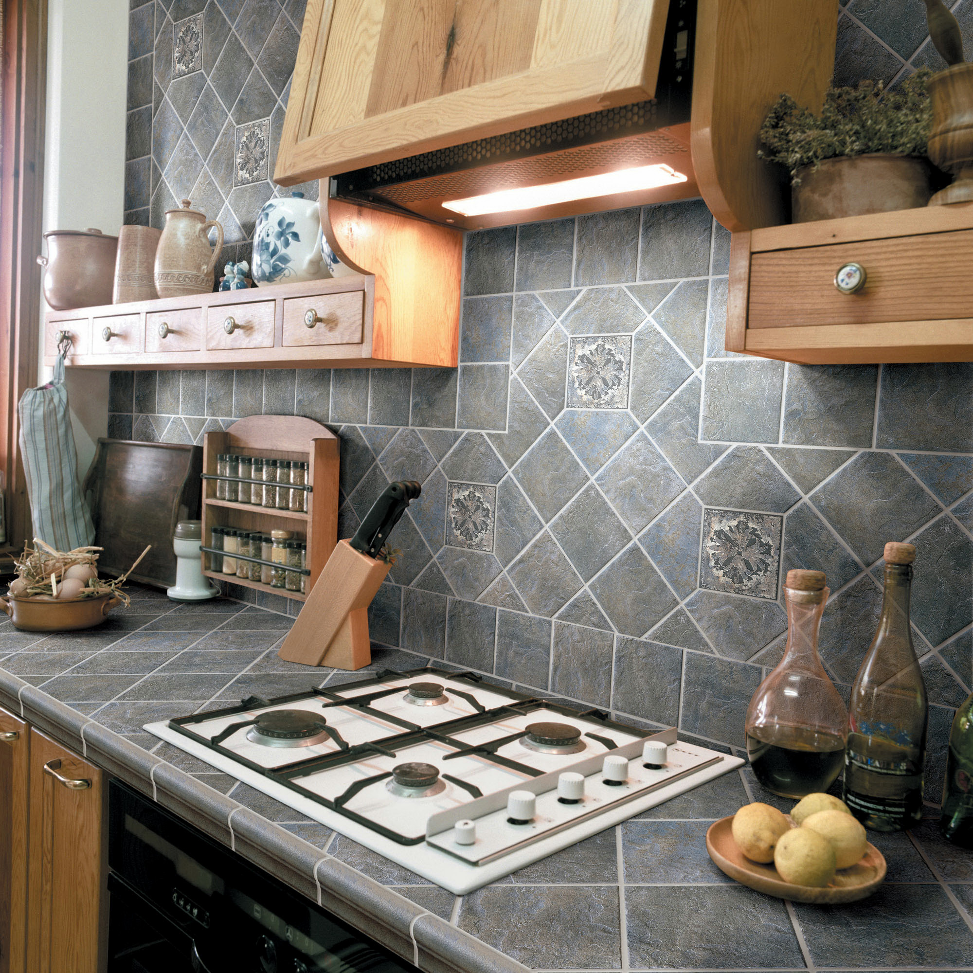 gray kitchen with tile countertops